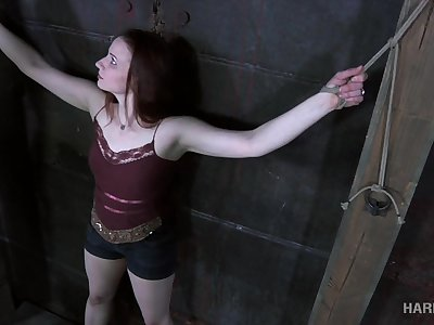 Red haired hooker Claire Adams is fucked in the dark BDSM square