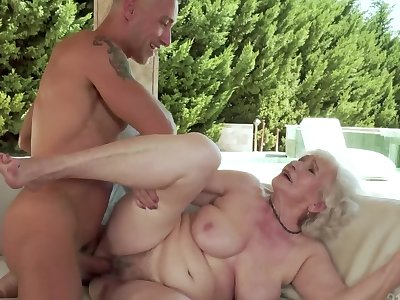 Naughty grandma is fucked on the couch by a hung stud
