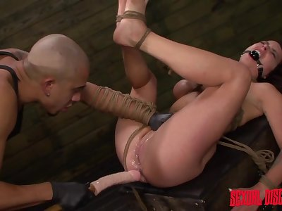 Slut trussed up by rope and fucked by a big dildo