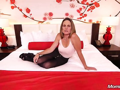 Emaciated brunette milf with saggy tits, Judith, is riding a hard white cock for a camera